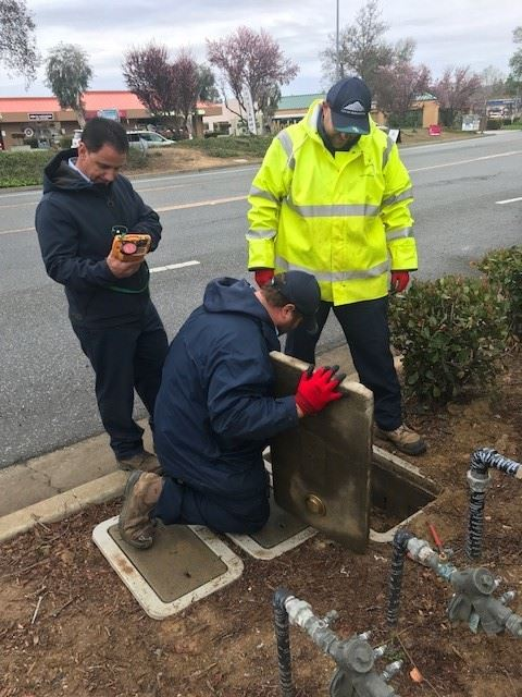Men checking a water meter